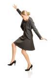 Mulher que anda com cuidado Fotografia de Stock Royalty Free