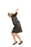 Mulher que anda com cuidado Foto de Stock Royalty Free
