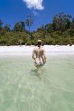 Mulher que anda fora do lago Foto de Stock Royalty Free