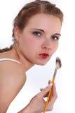 Mulher que aplica a composição fotografia de stock