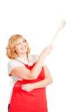 Mulher que aponta com colher de madeira Imagens de Stock Royalty Free