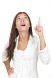 Mulher que aponta e que olha acima Fotografia de Stock
