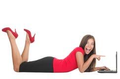 Mulher que aponta no portátil Imagens de Stock Royalty Free