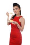 Mulher que come o bolo Fotografia de Stock Royalty Free
