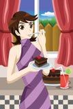 Mulher que come o bolo Fotos de Stock