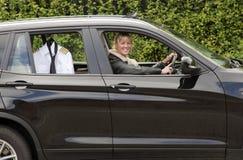Mulher que conduz ao trabalho Foto de Stock