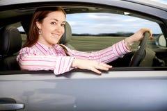 Mulher que conduz um carro Foto de Stock Royalty Free