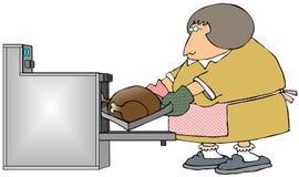 Mulher que cozinha uma Turquia ilustração royalty free