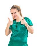 mulher que dá dois polegares acima Fotos de Stock Royalty Free