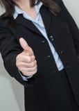 Mulher que dá os polegares acima Foto de Stock