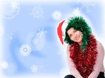 Mulher que desgasta um chapéu de Santa Imagem de Stock Royalty Free