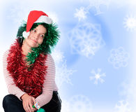 Mulher que desgasta um chapéu de Santa Fotos de Stock Royalty Free