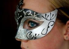Mulher que desgasta uma máscara Foto de Stock Royalty Free
