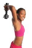 Mulher que exercita com Dumbbell Foto de Stock
