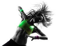 Mulher que exercita a silhueta da dança do zumba da aptidão fotos de stock royalty free