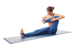 Mulher que faz a ioga - exercício de balanço do bebê Fotos de Stock Royalty Free
