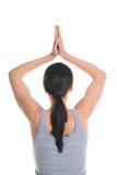 Mulher que faz o exercício da ioga. foto de stock