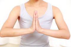 Mulher que faz o pose da ioga Foto de Stock