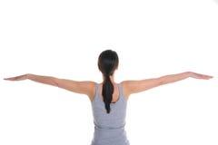 Mulher que faz a opinião traseira da ioga fotografia de stock royalty free