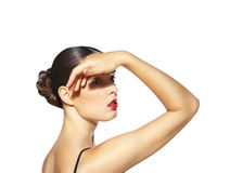 Mulher que faz a sombra por sua mão na face isolada Imagens de Stock Royalty Free