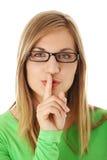 Mulher que faz a um sustento o gesto do quiet imagens de stock royalty free