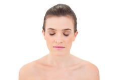 Mulher que fecha seus olhos Fotografia de Stock Royalty Free
