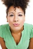 Mulher que funde um beijo Fotografia de Stock Royalty Free