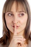 Mulher que gesticula para silenciar Fotos de Stock Royalty Free