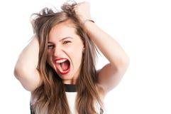 Mulher que grita e que agarra seu cabelo Imagens de Stock