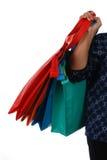 Mulher que guarda muitos sacos de compras Fotografia de Stock Royalty Free