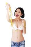 Mulher que guarda tipos da medida - Imagens de Stock
