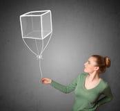 Mulher que guarda um balão do cubo Imagem de Stock Royalty Free