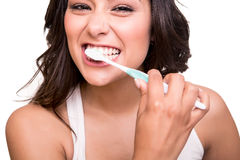 Mulher que guarda uma escova de dentes Fotografia de Stock