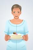 Mulher que guarda uma placa do bolo Imagem de Stock