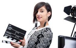 Mulher que guarda uma ripa Isolado no fundo branco foto de stock royalty free