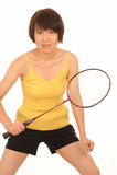 Mulher que joga o badminton Fotografia de Stock Royalty Free