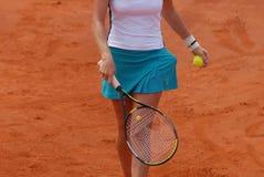 Mulher que joga o tênis Imagem de Stock Royalty Free