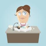 Mulher que lava os pratos Imagens de Stock Royalty Free