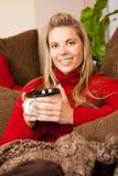 Mulher que lounging Imagem de Stock Royalty Free