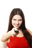 Mulher que mantém a tevê de controle remoto Imagens de Stock