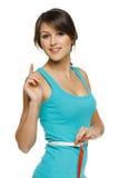 Mulher que mede sua cintura com uma fita de medição Imagem de Stock Royalty Free