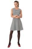 Mulher que modela Mini Dress With Arms Folded curto Foto de Stock