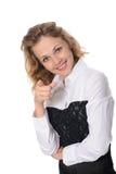 Mulher que mostra em algo por um dedo Fotos de Stock Royalty Free