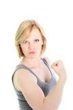 Mulher que mostra fora seu bíceps imagens de stock