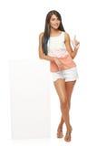Mulher que mostra o espaço em branco da cópia Imagem de Stock