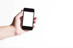 Mulher que mostra o telefone esperto com tela isolada Foto de Stock Royalty Free