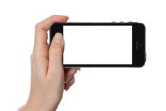 Mulher que mostra o telefone esperto isolado no branco ilustração stock