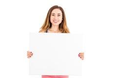Mulher que mostra a placa de propaganda Foto de Stock Royalty Free