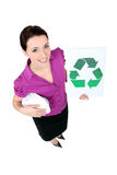Mulher que mostra recicl o logotipo Foto de Stock