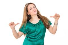 Mulher que mostra um dedo nsi mesmo, Imagens de Stock Royalty Free